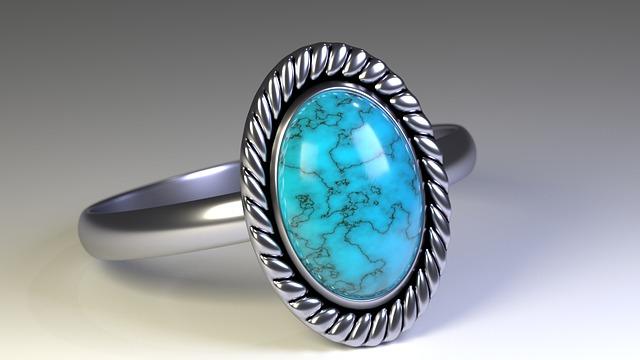 stříbrný prsten s velkým drahým kamenem